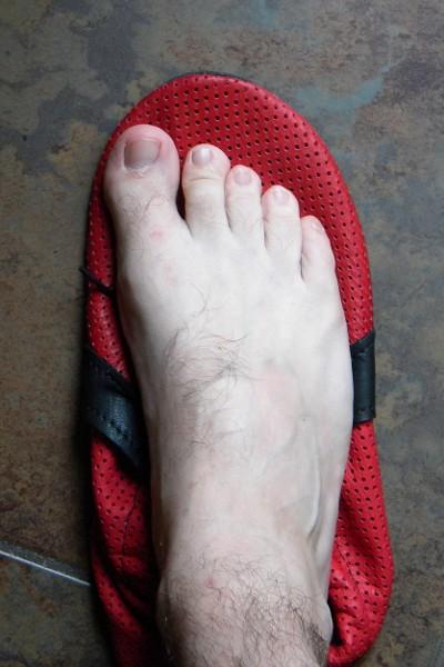 Big Toe Pokes Through Running Shoe